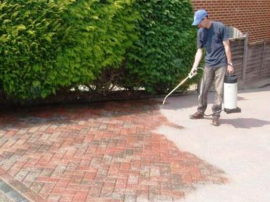 Guy Spray Sealing Patio